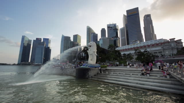 ws singapore city skyline with merlion statue - merlion fictional character stock videos and b-roll footage