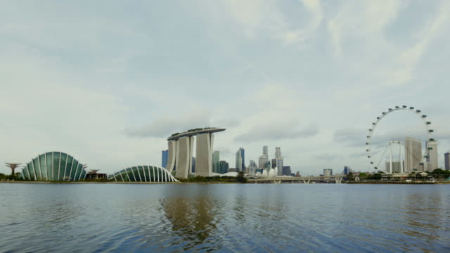 ws tl singapore city with singapore flyer and marina bay sands - singapore flyer stock videos and b-roll footage