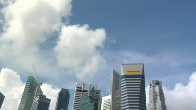 td singapore downtown with fountain and skyline of city in fullerton area of clarke quay area / singapore - merlion fictional character stock videos and b-roll footage