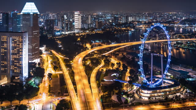 T/L WS HA PAN Singapore Flyer and Busy Traffic at Night / Singapore
