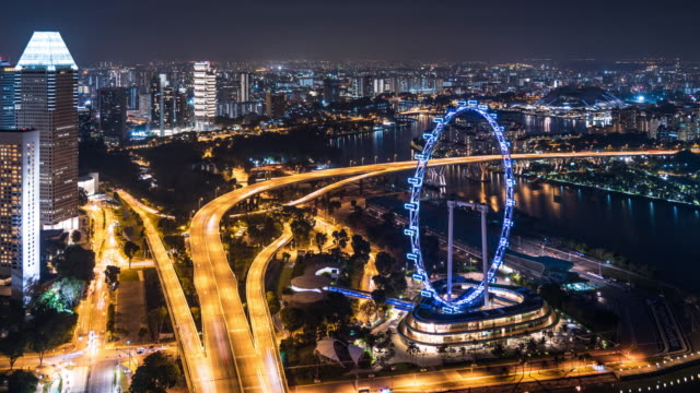 T/L WS HA ZO Singapore Flyer and Busy Traffic at Night / Singapore