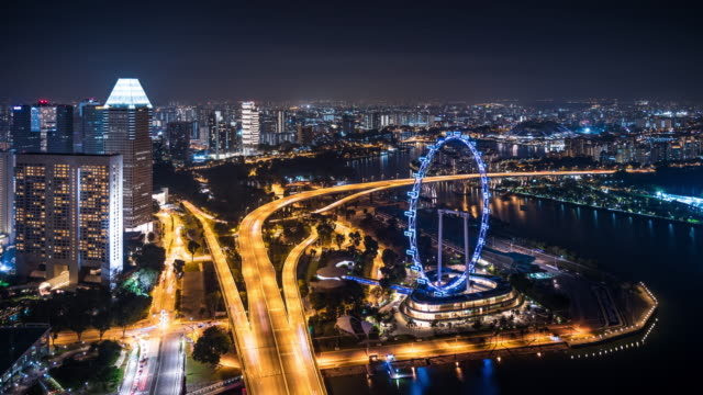 T/L WS HA Singapore Flyer and Busy Traffic at Night / Singapore