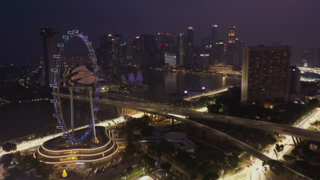 singapore flyer and urban skyline aerial view - national landmark stock videos & royalty-free footage