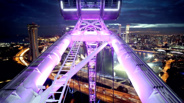 singapore flyer with skyline - singapore stock videos & royalty-free footage