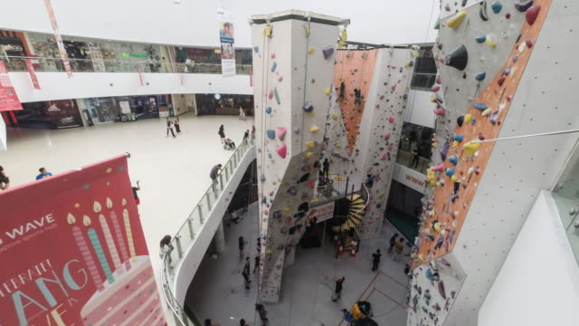 singapore, kallang wave shopping centre - climbing wall stock videos & royalty-free footage