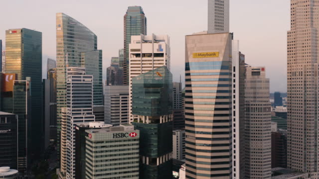singapore marina bay and the cbd at sunrise - singapore stock videos & royalty-free footage