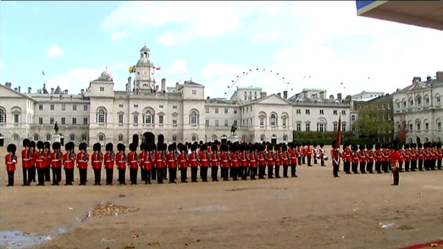singapore president state visit to britain day 1 horseguards parade more of carriages departing / guards lined up as national anthem heard sot / flag... - state visit stock videos & royalty-free footage