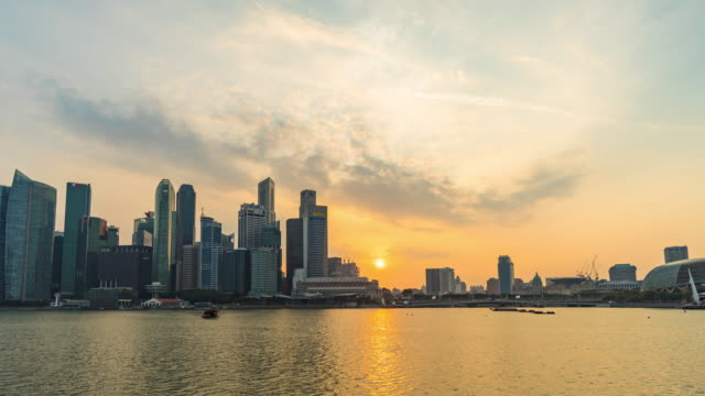 singapore skyline at sunset, day to night time lapse video - singapore river stock videos & royalty-free footage