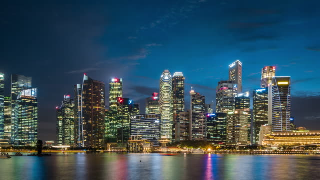 T/L WS PAN Singapore Skyline Day to Night Transition / Singapore