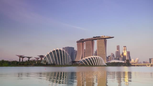 WS Singapore skyline reflecting on the water at sunrise.