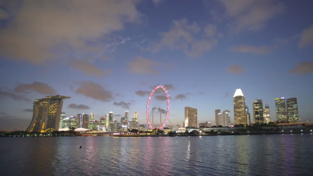 WS Singapore skyline with Singapore Flyer and Marina Bay Sands at dusk