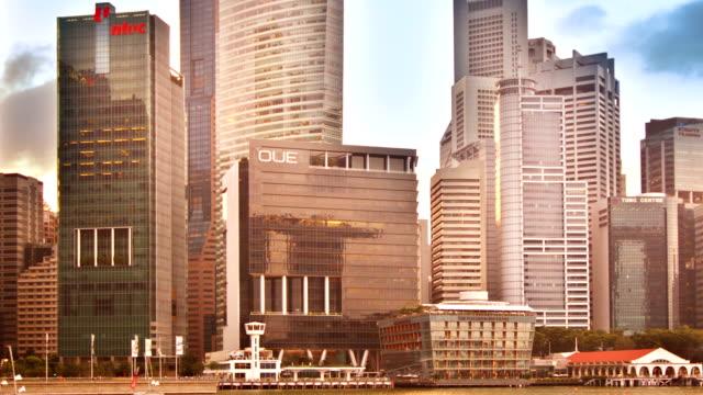 stockvideo's en b-roll-footage met singapore skyscrapers - cross processen