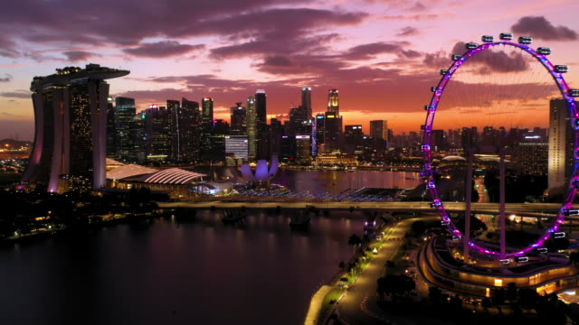 singapore sunset with marina bay sands, gardens by the bay. - river singapore stock videos & royalty-free footage