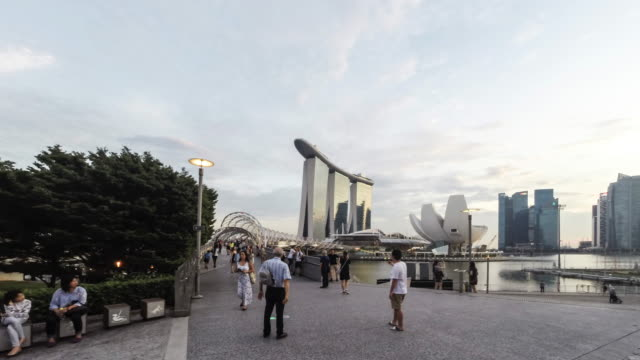singapore, the helix bridge and the marina bay sands - dusk stock videos & royalty-free footage