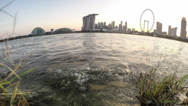 singapore, the marina bay sands and the singapore flyer - singapore flyer stock videos and b-roll footage