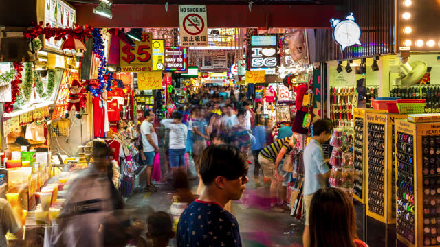singapore timelapse at night crowds at bugis street night ket with crowds - retail occupation stock videos & royalty-free footage