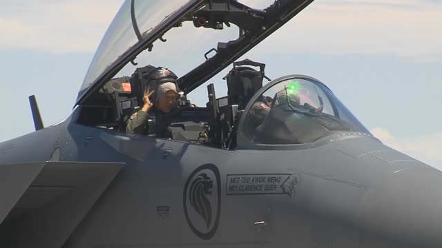 singaporean air force air crew members put on their helmets prior to taxiing out in an f15sg strike eagle assigned to the 428th fighter squadron at... - nellis air force base stock videos and b-roll footage
