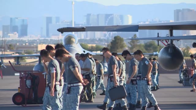 singaporean air force members perform a fod walk during red flag 143 jul 21 2014 at nellis air force base nev more than 30 countries have... - afterburner stock videos and b-roll footage