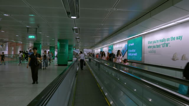 Singapore,Singapore - November 5 2018: Commuters using the moving walkway on the subway (MRT) underground system