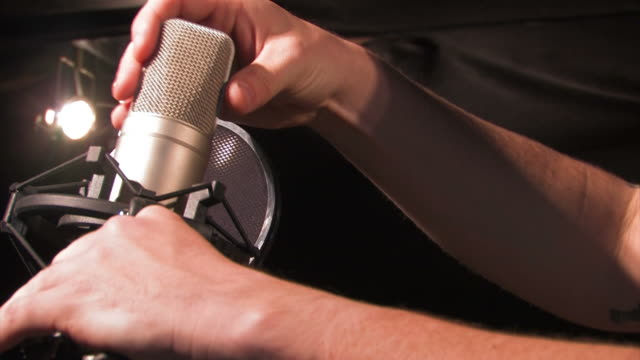 singer adjusting microphone - adjusting stock videos & royalty-free footage