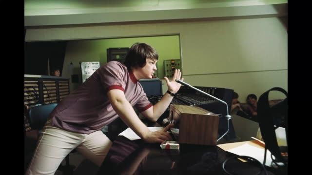 GIF Singer and mastermind Brian Wilson of the rock and roll band 'The Beach Boys' directs from the control room while recording the album 'Pet...