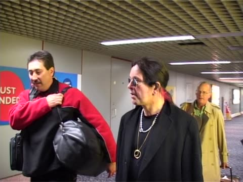 singer and reality tv star ozzy osbourne walks down a corridor at heathrow after arriving on a flight from la ready for concert appearances - reality fernsehen stock-videos und b-roll-filmmaterial