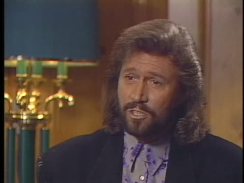 singer barry gibb of the bee gees discusses their singing career. - fame 個影片檔及 b 捲影像