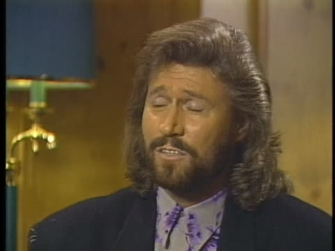 singer barry gibb of the bee gees tells how much the musical group enjoys playing in america. - the bee gees bildbanksvideor och videomaterial från bakom kulisserna