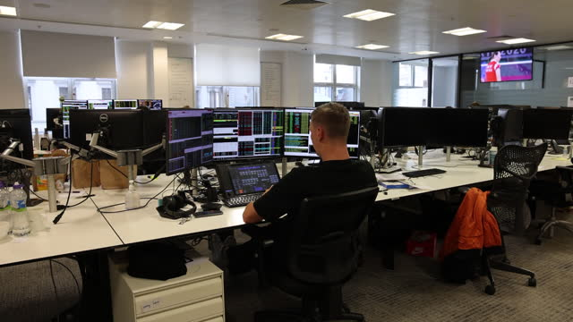 singer capital markets employee at desk using multiple computer monitors in london, england, uk, on monday, august 2, 2021. - working stock videos & royalty-free footage