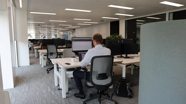 singer capital markets open space office, employee at desk in london, england, uk, on monday, august 2, 2021. - employee stock videos & royalty-free footage