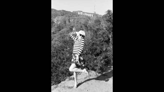 GIF Singer Debbie Harry of the New Wave pop group 'Blondie' poses for a portrait in March 1977 on a hill beneath the Hollywood Sign in Los Angeles...