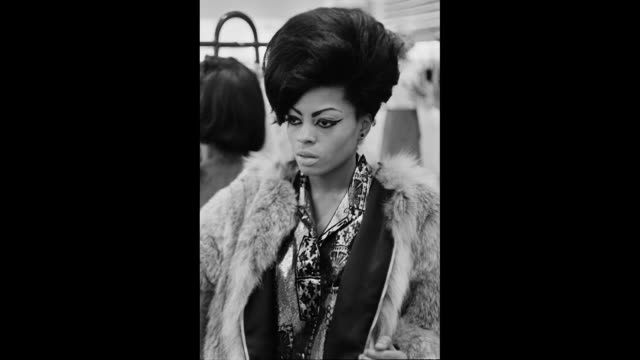 Singer Diana Ross shopping in a store and then posing for a portrait