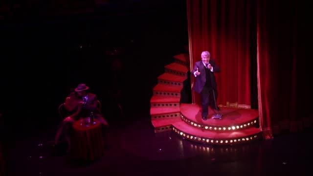 a singer during the tango show tango porteno in buenos aires argentina - tango ballo video stock e b–roll
