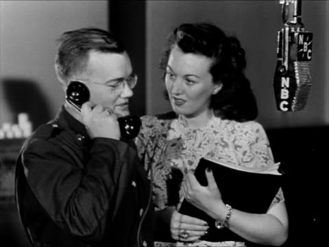 singer ginny simms standing w/ soldier he talking on telephone nbc mic asking for more candy soldiers laughing. soldier answering phil baker question... - gioco televisivo video stock e b–roll