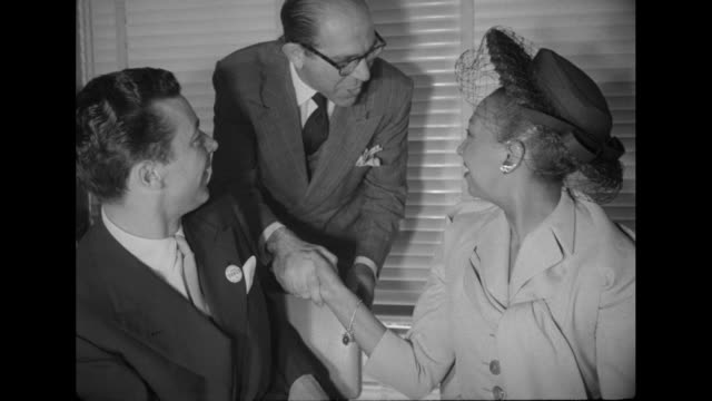 ms singer josephine baker sits at banquet table with her husband jo bouillon and others naacp banner hangs in background / ms baker shakes hands with... - naacp stock videos & royalty-free footage