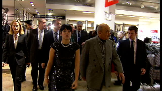 Singer Lilly Allen opens Harrods' Sale * * Bagpipe music heard during the following shots SOT * * Various of officials in department store TRACK /...