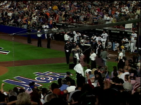 ws zo singer liza minnelli performs new york new york at seventh inning stretch w/ nypd nyfd members in uniform kicking like a chorus line partial... - shea stadium stock videos and b-roll footage