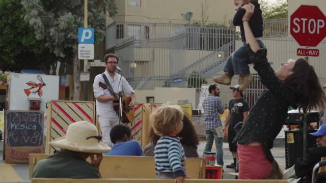 Singer performs on street - San Francisco, USA