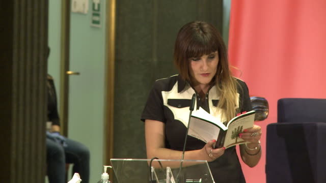 singer rozalen reads a poem during tribute to mario benedetti event in instituto cervantes - tribute event stock videos & royalty-free footage
