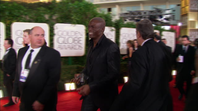 singer seal [seal henry olusegun olumide adeola samuel] walks down the red carpet holding camera at the beverly hilton hotel - seal singer stock videos and b-roll footage