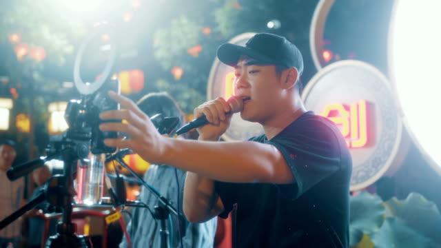singer singing in street at night - pop music stock videos & royalty-free footage