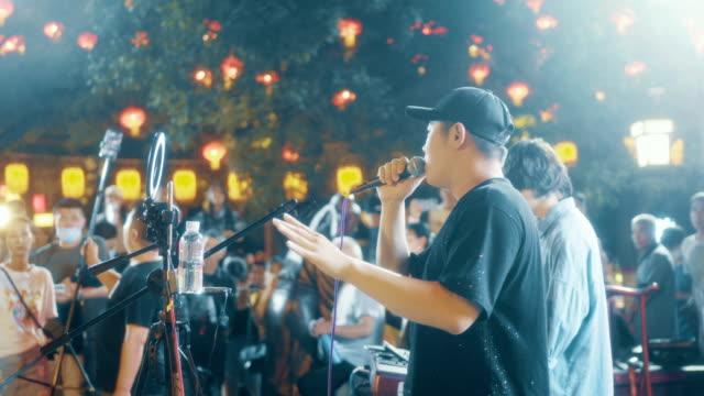 singer singing in street at night - pop musician stock videos & royalty-free footage