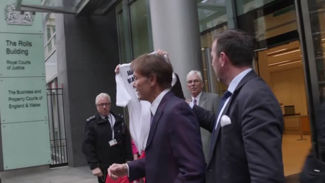 singer sir cliff richard leaves the high court in london after the first day of proceedings he is taking action against the bbc for the misuse of... - cliff richard stock videos and b-roll footage