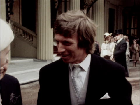 singer tommy steele receives obe england london buckingham palace ext tommy steele obe interview sot absolutely honoured going to fortnum mason as... - tommy steele stock videos & royalty-free footage