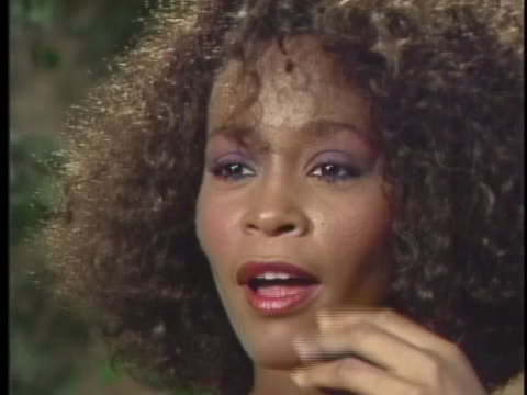 singer whitney houston says that if her success is orchestrated, than she wants to continue being orchestrated. - whitney houston stock-videos und b-roll-filmmaterial