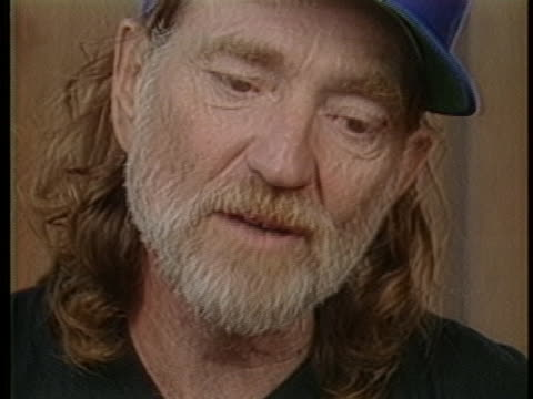 singer willie nelson says that funds raised from the 1985 farm aid concert will be quickly distributed because farmers face so many problems. - willie nelson stock-videos und b-roll-filmmaterial