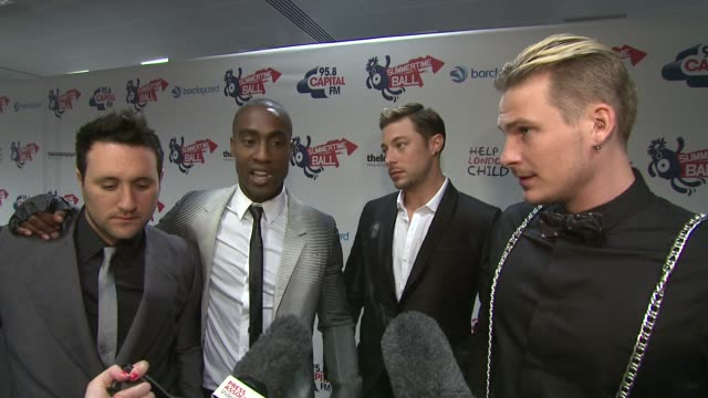 singers duncan james anthony costa simon webbe and lee ryan from blue all dressed in alexander mcqueen on being back together again after four years... - ronan keating stock videos & royalty-free footage