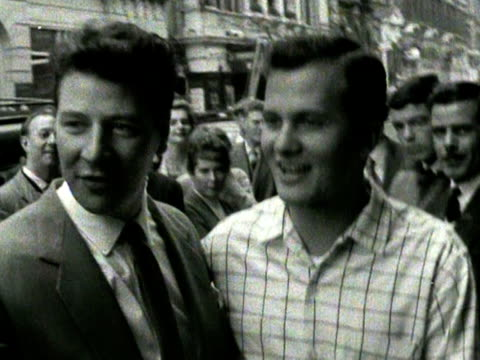 singers max bygraves and pat boone sign autographs outside the coliseum theatre. - max bygraves stock videos & royalty-free footage