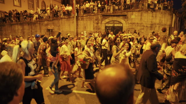 singing and dancing at nighttime traditional festival - portugal - cantare video stock e b–roll