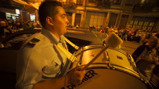 singing and dancing at nighttime traditional festival - portugal - ドラム容器点の映像素材/bロール